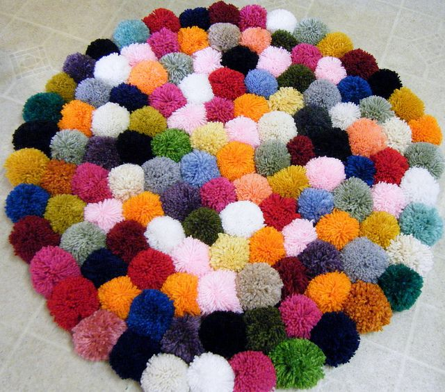 I want to make this for my girls: the makings of a pom-pom rug by fries in a cone, via Flickr