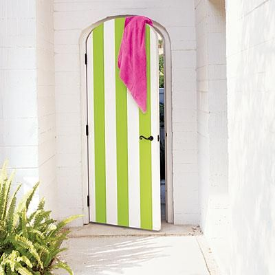This green and white striped door is all you need for a grand entrance! What a light, bright entryway.... Coastalliving.com