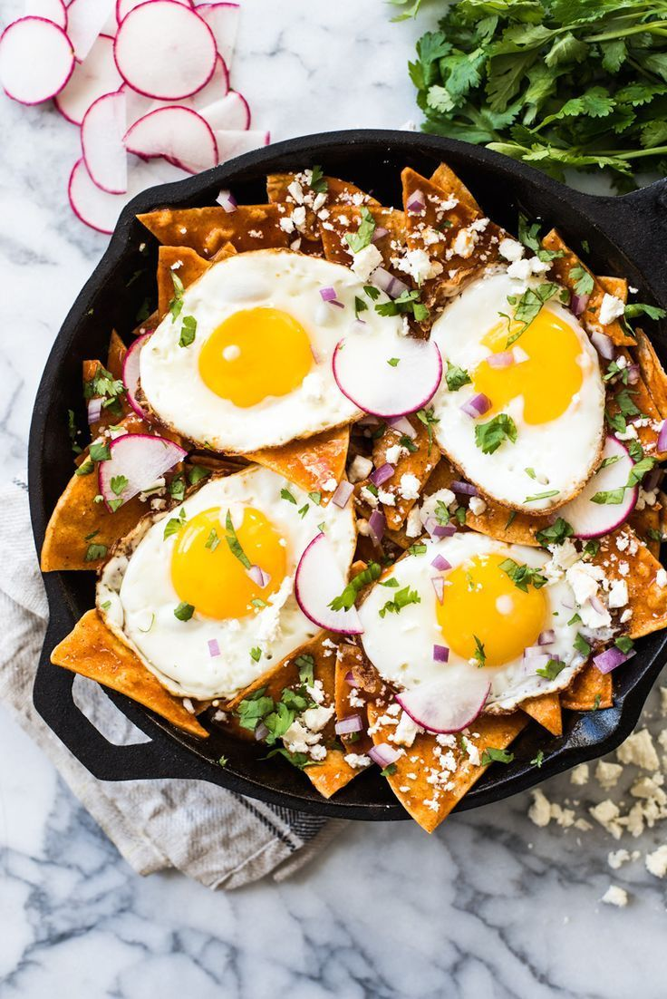 This Easy Red Chilaquiles recipe features baked corn tortillas, a red chile sauce and sunny side up eggs. Ready in 25 minutes! (gluten free, vegetarian) #Chilaquiles #mexicanfood #GlutenFree #vegetarian