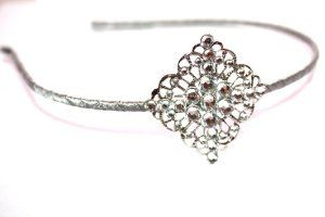 """Grey/silver Filigree Swarovski Crystals Head Band, Christening, Bridal, Flower Girls, Teen, Prom, Wedding, Black Swarovski Crystals by Chic Crystals. $19.99. Very pretty and one of a kind. This listing is for Grey/Silver unique headband but comes in so many different colors. Each headband is wrapped with ribbon and the size of the band is 1/8"""" Filigree metal style pattern on the side to add such a great detail with Swarovski Rhinestones. Crystals in varying sizes from small to HU..."""