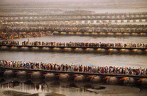 Crowds gather for the Kumbh Mela festival on pontoon bridges across the Ganges. Allahabad, Uttar Pradesh