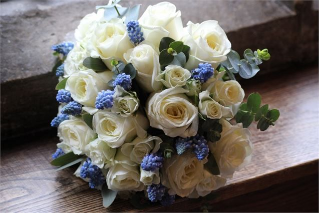 bridal handtied bouquet of ivory roses and spray roses and blue muscari - THE FINE FLOWERS COMPANY