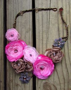 How to make fabric flowers and how to make them into a necklace.