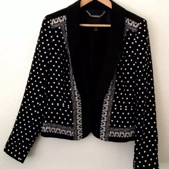 """White House Black Market silk blazer black Sz 12 White House Black Market silk polka dot blazer in size 12  Black with white polka dot, Shawl collar,two eyes & hooks at waist  100% Silk Shell, 100% polyester lining  Scroll pattern across shoulders, down front and across back at shoulders and bottom.  Pleat at back at bottom. Narrow solid black lapels. Double front hook fastening.  Fully lined.  Padded shoulders  Measurements are taken laid flat  Armpit to armpit across: 21""""  Length from…"""
