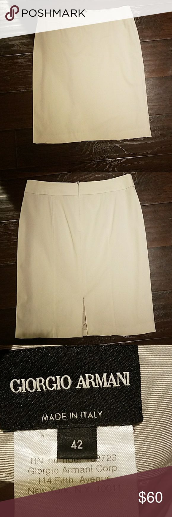 """Giorgio Armani beige pencil skirt Like new Giorgio Armani skirt with no signs of wear. Fully lined with an invisible back zipper. Made in Italy Fits an 8/10  Waist 16"""" Hips 19"""" Length  22.5"""" Giorgio Armani Skirts Pencil"""