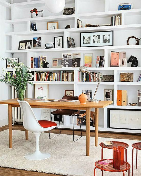 desk in front of bookshelves