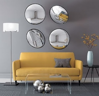 This works .... yellow couch, grey walls, but black and white family prints above couch