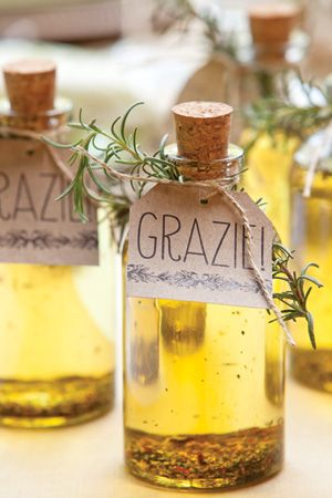 they say:  Send guests home with a taste of Italy. Herb-infused olive oil is easy to prepare yourself. Just place 1 tablespoon dried herbs in a small glass bottle, and fill with olive oil. Top with cap, and let stand for at least 1 week and up to 2 months. Finish with a favor tag, a piece of jute, and a fresh-herb garnish.