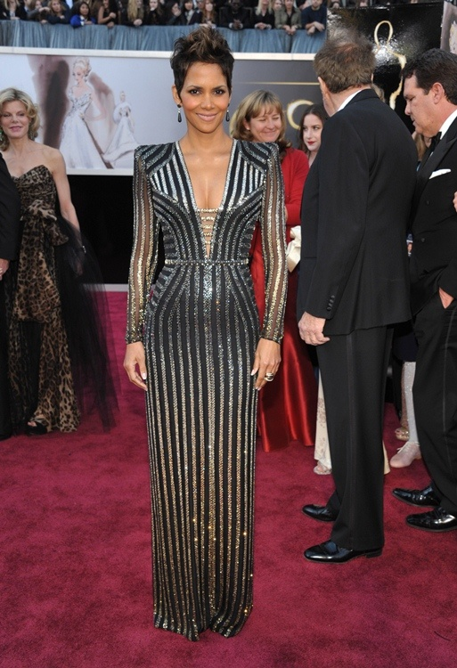 Halle Berry in Versace at the 2013 Academy Awards    --    For the gala, that celebrated the 50 year James Bond tribute, the actress said that she was going to channel her inner Bond girl.  Mission accomplished!