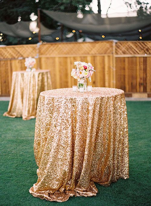 Cover cocktail hour tables with gold glittery tablecloths | Brides.com || Amara • Bridal Registry • ||
