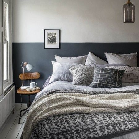 Fill your bed with mismatched cushions to create a warm and cosy feeling bedroom
