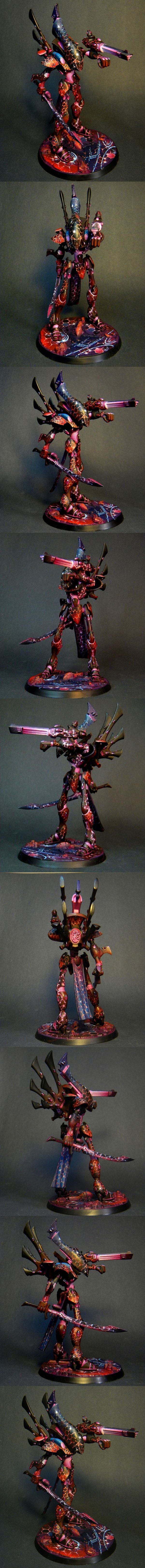 Warhammer 40k Eldar Wraithlord. He real gold here is the enormously intricate paint job and the play of lighting across the entire model