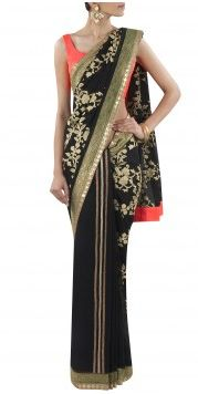 OHAILA KHAN - OKC0513MA02 Price - This black and gold chiffon georgette sari features gold kasab jaal embroidery on palla and kasab lines in skirt and pleat section. It has an emerald green banarasi and gold sequin diamond border running on the entire sari with a neon coral pink raw silk facing.