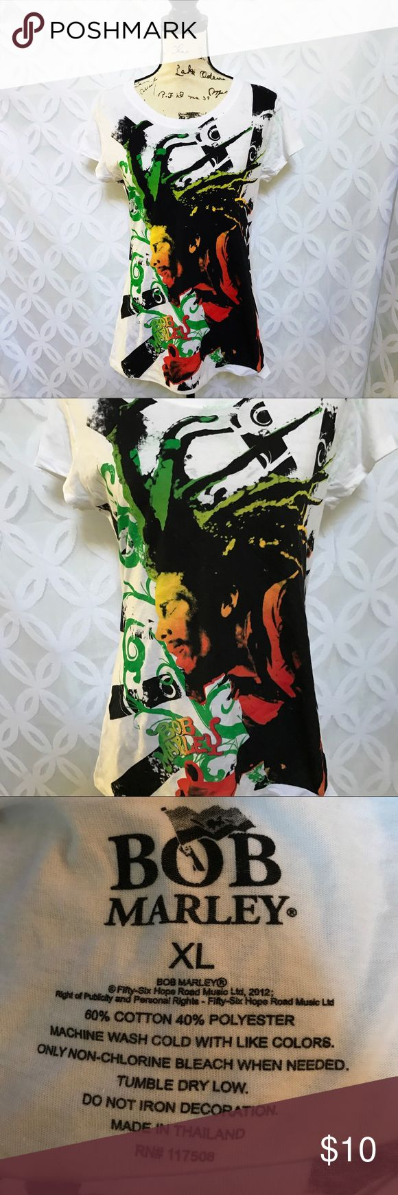 """Bob Marley Rastaman Reggae Jamaican Colors Tee Bob Marley Rastaman Reggae Jamaican Colors Tee NWOT.     Measurements Laying Flat Size 🔹 XL Armpit to Armpit 🔹19"""" Shoulder to Hem 🔹27"""" Bundle to Save 🤓 Sorry NO outside transactions 🚫 NO trades 🚫 Reasonable Offers welcomed 👍 NO Low balling 👎 NO modeling 👎 NO Holds👎 All items from a pet 😼and Smoke Free Home  Happy Poshing 🤗 Bob Marley Tops Tees - Short Sleeve"""