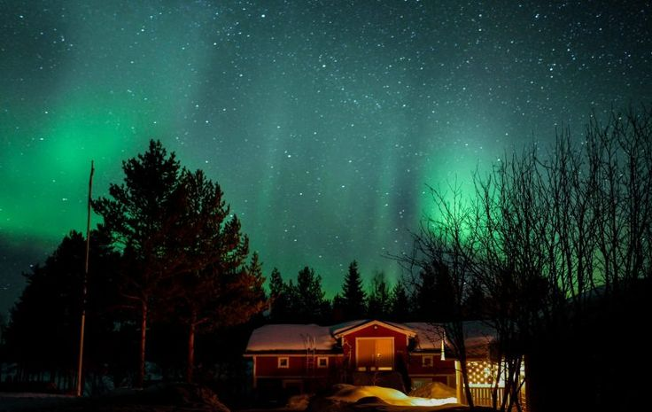 Northern Lights over the Puolukkamaan Pirtit reindeer farm in Pello in Lapland