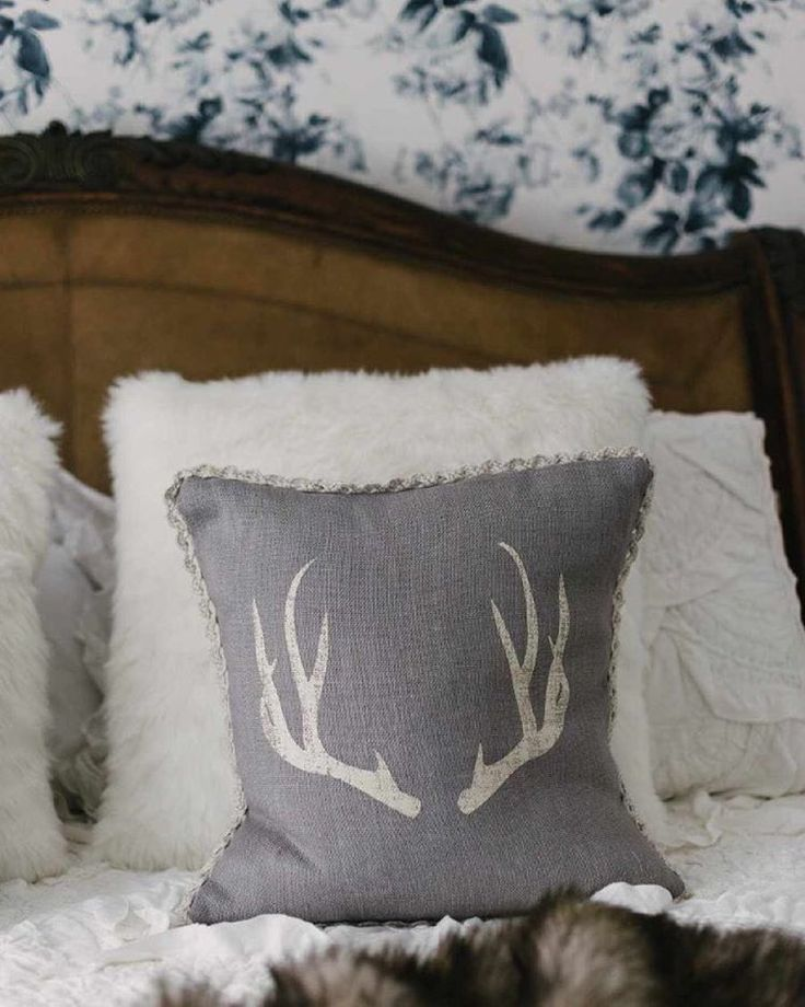Neutral antler pillow from Royal Scout and Co. Photo by Kindred Vintage on Instagram