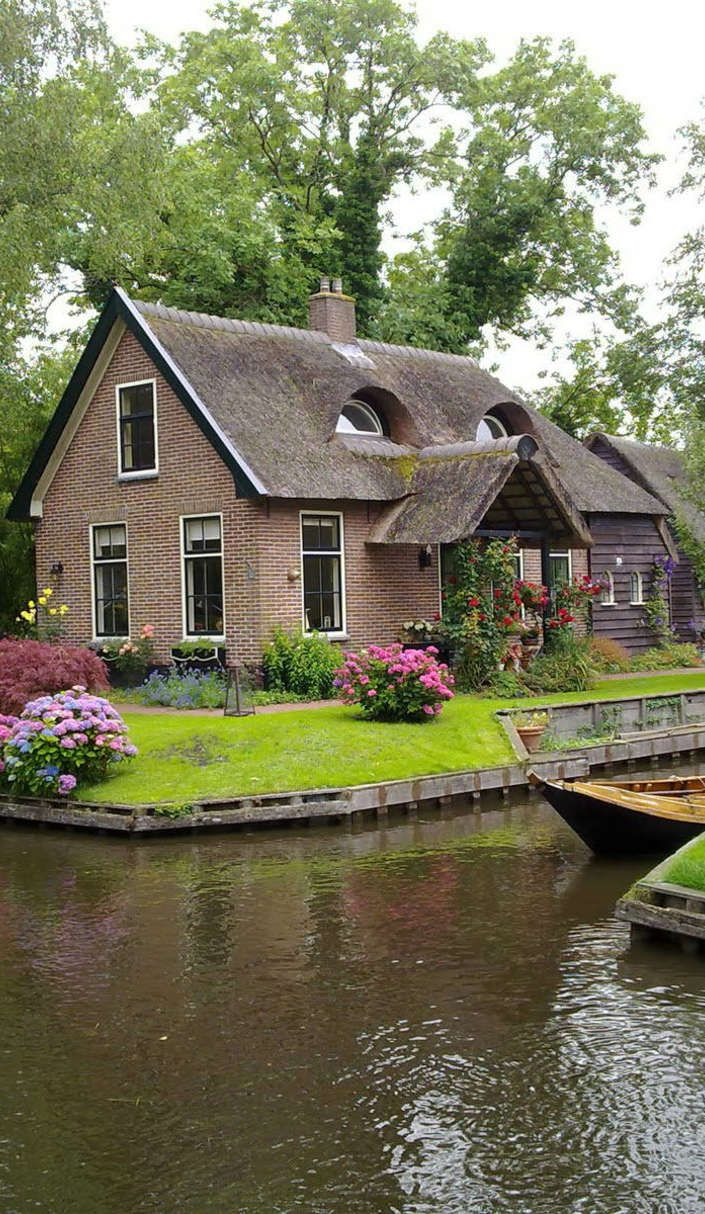"Giethoorn is one of the most enchanting villages in the world. It's a town with no roads. Like, seriously. None. Instead the 3,000 inhabitants move about by canoeing over 4 miles of canals and walking on 180 bridges.  The Netherlands village was founded in AD 1230 by fugitives who had escaped from the Mediterranean. It's since been given the nickname the ""Venice of the Netherlands."" In addition to boaters, the townsfolk regularly cycle and sail."