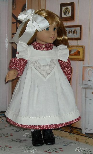 Nellie's beautiful pink dress and lovely pinafore by Kathy K13, via Flickr