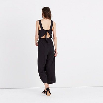 An easy wide-leg jumpsuit with an undeniably pretty back detail—it ties in a bow above a peekaboo cutout. /