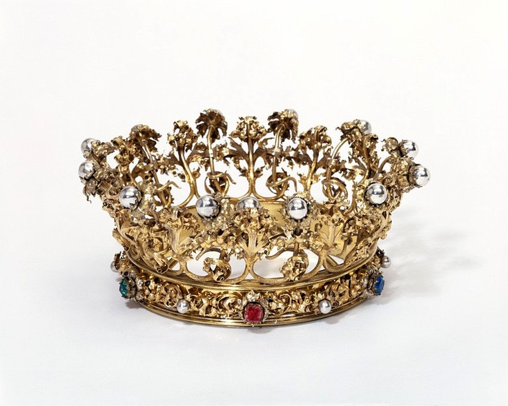 The crown is a symbol of virtue and martyrdom as well as an emblem of sovereignty. This 1863 German crown was made for a statue of the Virgin Mary, to remind worshipers of her coronation by Jesus Christ and her high status as 'Queen of Heaven'.
