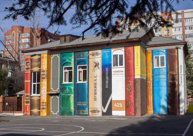 """An art group in Tyumen, Russia going by the name of """"Color of the city"""" have transformed a run-down building in a local schoolyard into a painted bookshelf."""