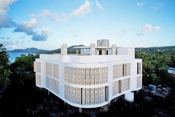 El Blok, a new boutique hotel designed by Puerto Rico–based Fuster + Architects, is located in the small town of Esperanza, on the popular vacation island of Vieques. Glass-reinforced-concrete panels punctured at irregular intervals by small ovoid cutouts adorn the curvilinear façade, which mimics the shape of the nearby shoreline.