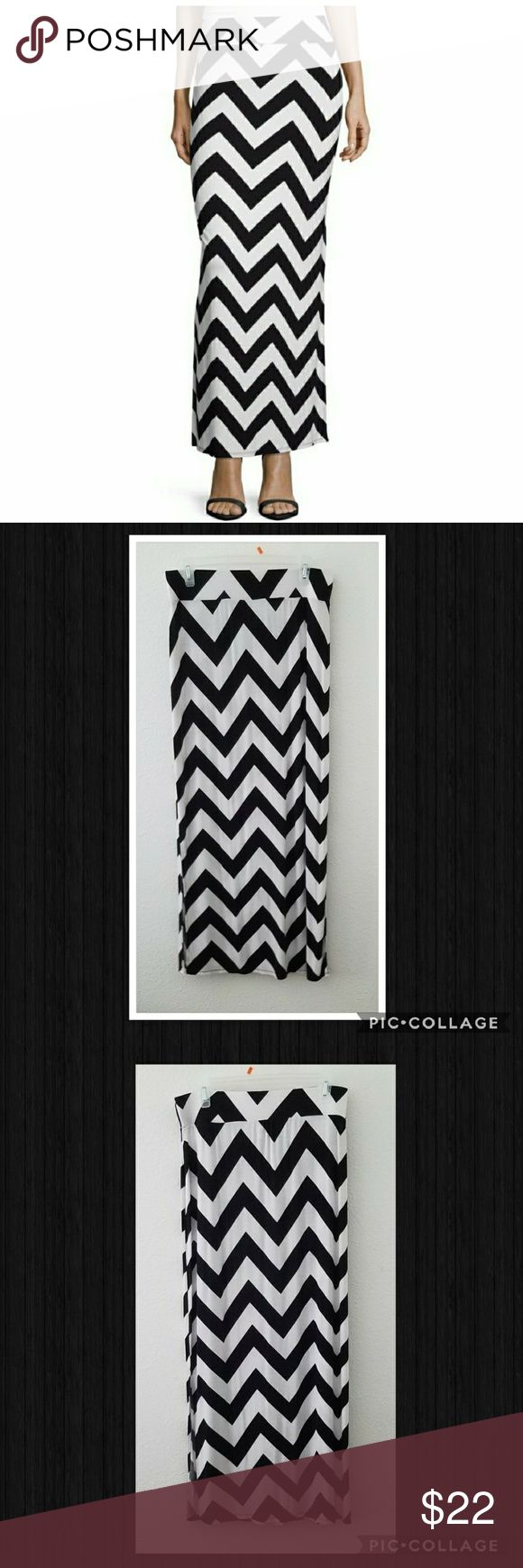 """🔺 Black & White Chevron Maxi Skirt {a.n.a} a.n.a black & white chevron maxi skirt with side slits. EUC, wore once! Fabric is a little sheer. Super soft fabric, perfect beachwear!  95% rayon, 5% spandex • hand wash only  Length: 38"""" Waist: 15.75"""" Slits are 16"""" long on each side a.n.a Skirts Maxi"""