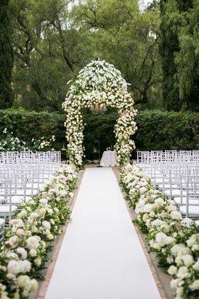 Wedding ceremony at The Beverly Hills Hotel white rose hydrangea flowers chuppah aisle runner