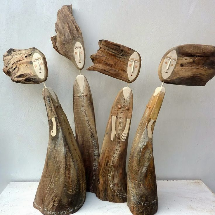 wooden sculptures in the shape of Lynn Muir people or what you can do with wood
