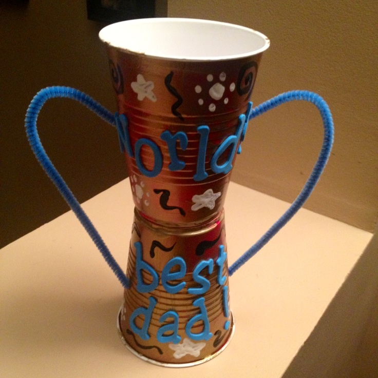 Father's Day Trophy Craft for Kids: super easy and cheap to prepare!    All you need are two plastic cups, liquid glue (or glue gun), two pipe cleaners, paint brushes, paint, and craft decorations/supplies (glitter, foam letters, etc.)