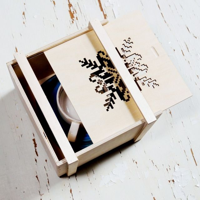 """Packaging Design  """"This wooden box is designed by Ewa Dagny and is inspired by artworks of a Norwich artist Randi Antonsen, who also colaborates with YouArtMe.  They are produced hand-made and according to the fair trade principles by a local, native and family owned company from a little village called Górsk (Gorsk) near Toruń (Torun) in Poland."""