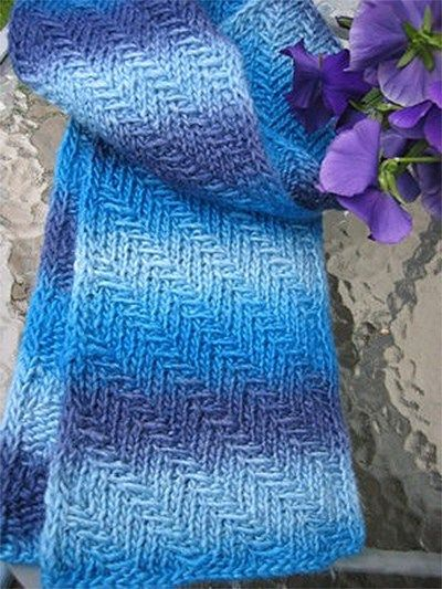 Free Knitting Pattern Prismatic Scarf - Huan-Hua Chye's easy scarf uses a diagonal slipped-stitch rib pattern that creates slanting rays of color especially designed to show off variegated yarn, though the texture looks great in solid colors too. Pictured project by Maj
