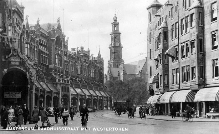 1940's. Raadhuisstraat with in the background the Westertoren. Raadhuisstraat is a street in the center of Amsterdam located between Nieuwezijds Voorburgwal and Prinsengracht. The street was named after the former city hall on the Dam Square, now the Royal Palace. The Raadhuisstraat was built in 1895. #amsterdam #1940 #Raadhuisstraat