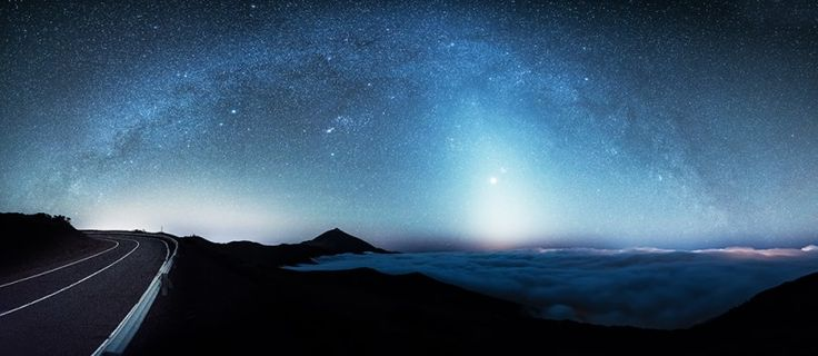 Zodiacal Light over Mount Teide cloudscape in Tenerife with Venus to the centre of the light