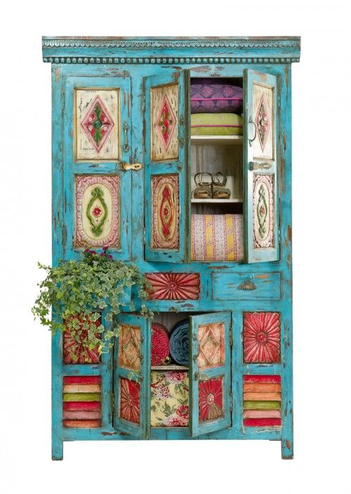 that hutch at alyssa's that she doesn't want, maybe you could get from auntie bobbie and paint fun boho colors like this and put your tv inside (if it would fit)