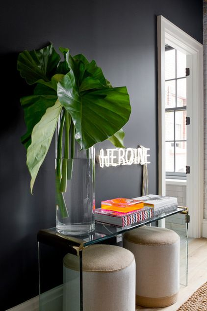 Great match! A glass console table and two round ottomans. #entryway #brandsource