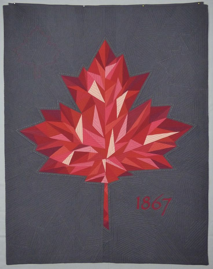 Absolutely stunning quilt by Michele-Renee Charbonneau of Quilt Matters! She created this quilt to celebrate Canada's 150th anniversary that is happening next year, and the pattern is her own. She used 13 different red fabrics to represent the 10 provinces and 3 territories that make up Canada. Her goal was to make the mosaic in the leaf look fragile, as if made from glass, and we think she accomplished that beautifully. The quilting was done with her walking foot on her domestic Bernina…