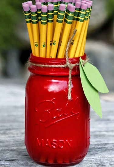 Get your fall fruit fix by crafting these apple-themed jars, perfect for holding pencils, rulers, or other school supplies.