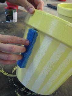 Cut a sponge to stamp stripes on a planter