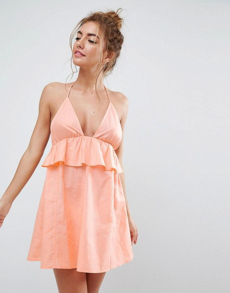 Buy it now. ASOS Beach Halter Sundress With Frill - Orange. Beach dress by ASOS Collection, Lightweight cotton and linen-mix fabric, Plunge halter neck, Frill overlay, Tie back fastening, Regular fit - true to size, Machine wash, 47% Cotton, 41% Viscose, 12% Linen, Our model wears a UK 8/EU 36/US 4 and is 172cm/5'7.5 tall. Score a wardrobe win no matter the dress code with our ASOS Collection own-label collection. From polished prom to the after party, our London-based design team scour the…