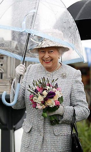 The coloured border on the Queen's umbrellas are thinner than the regular birdcage umbrellas, so she is more visible to the public.  Photo: © Getty Images