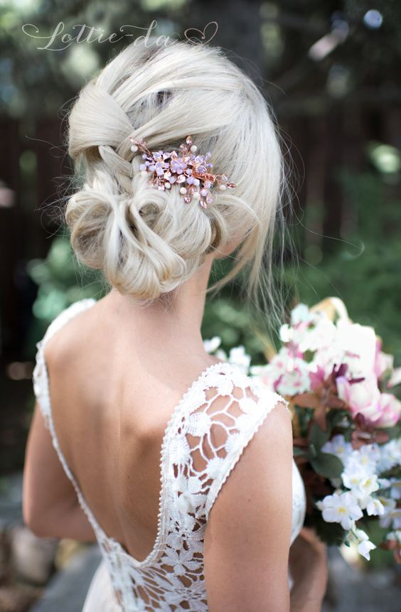 Stunning low updo wedding hairstyle with pink jewel accessory; Featured Hairpiece: Lottie Da Designs