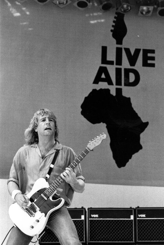 Peak of his powers... Rick on stage during Live Aid in 1985
