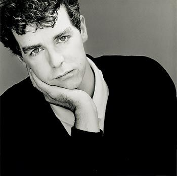 Neil Tennant of Pet Shop Boys when he was much younger. I had SUCH a huge crush on him - you know, way before I even knew or understood what gay even meant and before he came out of the closet. I was devastated.    Interesting to find out he was the editor of Smash Hits before he became famous with Pet Shop Boys - totally bought & read that every time we went to England! :)