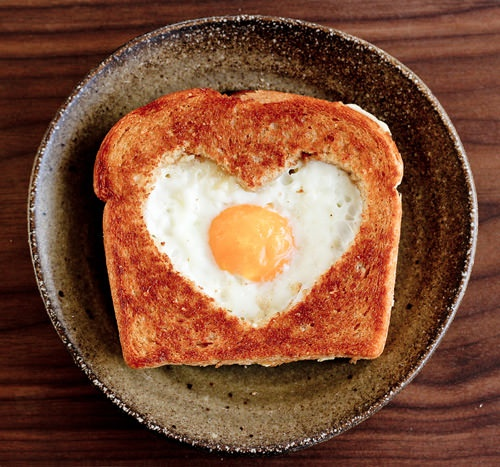 egg in a heart shaped nest.