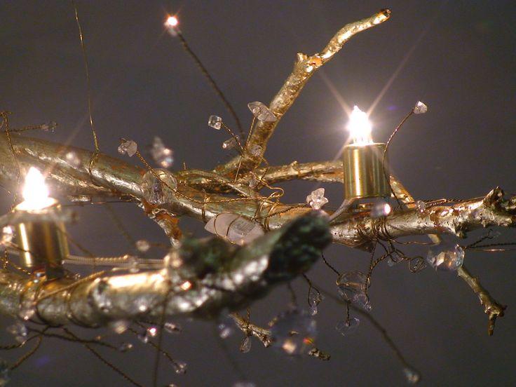 Tree Branch Crystal Chandelier with 22 KT gold leaf, natural quartz crystal, swarovski crystal, halogen bulbs. $3,500.00, via Etsy.