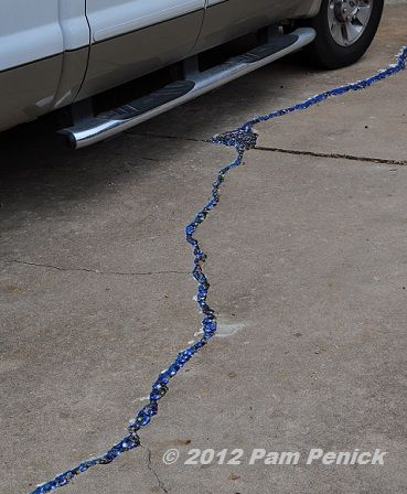 """When life gives you cracks, make rivers!"" fill driveway cracks with blue"
