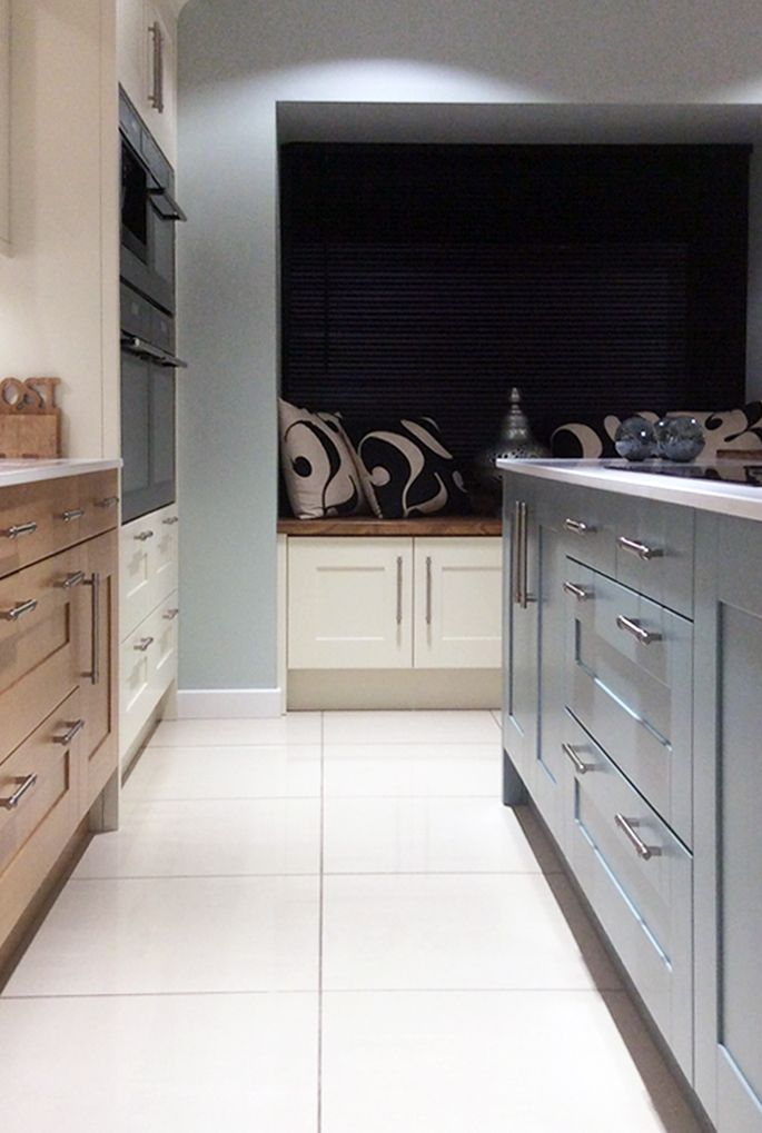 Painted Sheraton Shaker Kitchen in Blue & Ivory, mixed with Lissa Oak.  For more painted kitchen options, please see http://www.sheratonkitchens.co.uk/kitchens?finish%5B%5D=Woodgrain+Effect+Painted&finish%5B%5D=Painted+Timber&finish%5B%5D=Matt+Painted