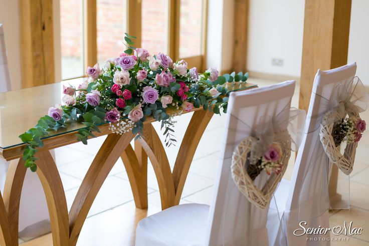 Vintage pink flowers for the ceremony at Rivervale Barn by www.tarniawilliams.co.uk