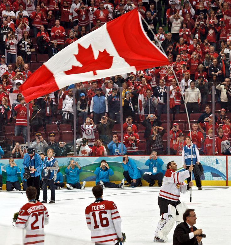 Luongo waving the flag, after Canada won hockey GOLD at the 2010 Olympics